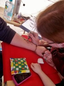 Hennatopia, Hillsboro — Veronica Lacquement, artist and owner of Hennatopia, doing henna at Carnival Days 2012.