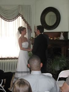 The Columbian Inn, The Columbian Inn, Columbia — wedding ceremony in front of Fireplace