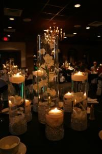 White Linen Events & party rentals, Tampa — Floating candles with cymbidium orchids at Golden Eagle Country club in Tallahassee