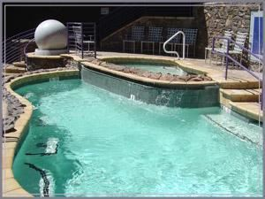 Party Pool, Chase Field - Home of the Arizona Diamondbacks, Phoenix — If you are looking to make a big splash this year, look no further than the Leslie's Pool Zone! The pool and spa sit nearly four feet above ground, allowing fans in the pool to enjoy an unobstructed view of the action on the field as well as additional areas to view the game. The Diamondbacks incorporated the use of natural stone finishes, including canterra and flagstone to give the pool a feel of an Arizona backyard. The Pool Zone also features a private bar area, plasma television and plush patio seating.