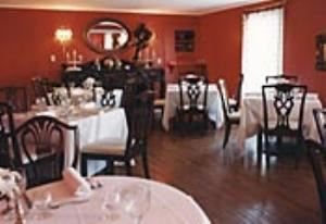 Main Dining Room, The Willow Creek Inn, Vale — Our formal dining room is beautiful with antique furnishings and French lace drapery. On a clear day, we can promise dining in the evening under the moon and stars.