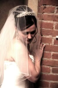 Photography by Valeri Hoffman Bradford, Lancaster — bride leaning on brick-artistic bridal