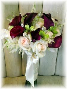 MaryJane's Flowers, Berlin — Beautiful bridal bouquet of bridal akita roses with hot cherry calla lilies with green orchids accented with astible. At MaryJane's Flowers we do all kind of bouquets this is one of my most resent favorites.