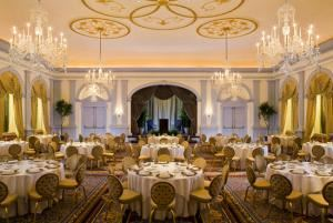 Ballroom, The Fairfax at Embassy Row, Washington — Up to 250 guests are comfortably accommodated in the The Ballroom (2,600 square feet) at the Fairfax at Embassy Row, a grand location for your Washington, D.C. wedding. Our hotel strives to reach beyond all expectations. Guests of The Ballroom are invited to watch the wedding ceremony from the Balcony Room, which overlooks the larger space and is also a lovely perch for a cocktail reception. Once the main reception begins, a separate entrance into a gleaming marble foyer leads to spacious and elegantly appointed space that includes a large dance floor and customized table settings.