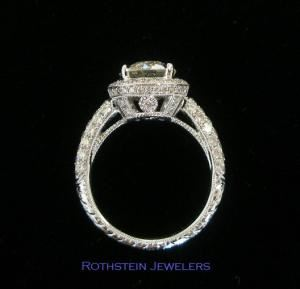 J. Rothstein & Co., Beverly Hills — Beautiful and Romantic diamond engagement ring with halo, crown, and hand-engraved band full of pave' diamonds. 2 carat center diamond. Retail priced at $36,000; our client had us make it for him for only $18,000. Smaller sizes are available.