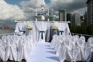 The Wedding Yacht, Vancouver — The Sky Deck - A ceremony on our Sky Deck complete with custom draping, flowers and chair covers