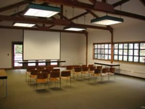 The Large Meeting Room, University of Washington Botanic Gardens, Seattle — The Large Meeting Room is 26' x 42' (approximately 1092 sq.ft.) and has a legal capacity of 95 standing and 75 to 80 (maximum) in a full-service seating arrangement.