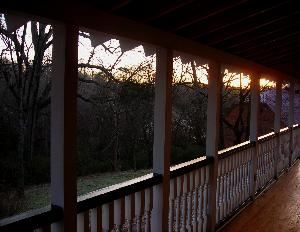 Sleepy Hollow Veranda, Sleepy Hollow, Clemson — 50 x 12 plus 30 x 12 Veranda overlooking back field and J. C. Stribing Historic Barn.  Entrance from house and side yard.  Great for small wedding, reception, bridesmaid luncheon, etc.