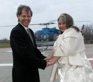 Niagara Falls Helicopter Wedding - Weddings in the Sky, Niagara Weddings and More, Niagara Falls — An excited bride and groom prepare to board the helicopter