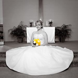 Jeff Coe Photography, Gardner — Bride in black and white holding yellow flowers.  Shot in a small church in Raymore, MO.