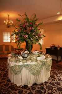 Batik Room, Gramercy Mansion Bed & Breakfast, Stevenson — The Batik Room boasts hardwood floors, a chandelier, and antique furnishings, access to the outdoor courtyard from French doors and easy access to handicap-accessible restrooms.  Ideal for small meetings or retreats.