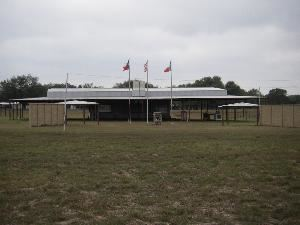 The Bluebonnet Pavilion, Sandy Oaks Ranch, Devine — The Bluebonnet Pavilion is a 7,700 square foot outdoor covered pavilion which include: 6' x 15' - 3 tap keg serving bar, four televisions and public announcement system. The indoor facilities include: 225 square foot climate control room and restrooms.