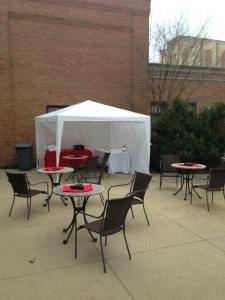 Custom Cigar Services, Beachwood — This is a basic setup that we displayed at a recent show.  The weather was threatening all day but we were able to put up something functionable.  We served cigars and ice cream out of the lounge that night.