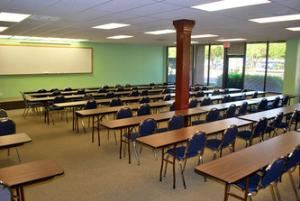 Cypress Room, Spring Branch Meeting Rooms, Houston — The Cypress Room whiteboard and built in platform/stage.