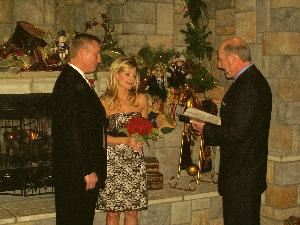 Formal Wedding Ceremony, Can A Lope Wedding Ministers — Get Married @ Chateau On The Lake Branon MO. Photo was taken @ Chateau On The Lake @ Christmas time in the library.