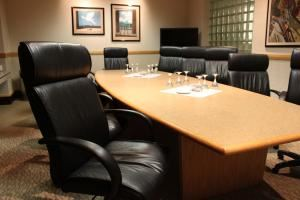 Executive Boardroom, Best Western Plus - InnTowner & the Highland Club, Madison — Our Executive Boardroom is designed to encourage discussion and work in a private, comfortable, and state of the art setting. The room features executive seating, television with DVD/BluRay player, glass block windows, private washroom, and complimentary high speed wireless. Now equipped with a InFocus MonodPad©, our clients may now present, video conference, annotate, and collaborate on this giant in-room table with meeting participants in the room and around the world.