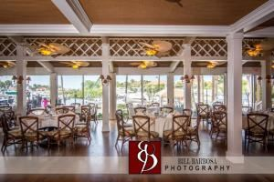 Main Dining Room, Out of the Blue Waterfront Weddings & Events, Jupiter — Out of the Blue offers seating up for up to 140 guests. Our floor to ceiling windows offers amazing views of the Loggerhead Marina located in the gated and private community of Jonathan's Landing.