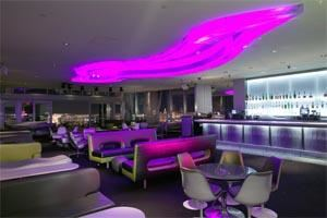 Ghostbar - Las Vegas, Las Vegas — High above the glittering expanse of Las Vegas, the 8,000 square foot Ghostbar is a sultry and sophisticated indoor-outdoor lounge and sky deck on the 55th floor of the Palms Casino Resort. Indoors amid the seductive shadows, the sleek, chic Ghostbar offers ultra lounging luxury among an ethereal color scheme of silver, white, greens and grays. Fourteen foot floor-to-ceiling windows offer a dramatic view of the night sky and the city below; a 30 foot ghost-shaped soffit in the ceiling changes colors as a deejay spins an eclectic music mix. Patrons can luxuriate on the custom, ultra-contemporary lounging furniture, seek privacy in the intimate seating arrangements or VIP lounge, or mingle at the terrazzo bar. Behind the bar, shelves of premium spirits glow with the incandescence cast by back-lit panels of acrylic-encased fabric.