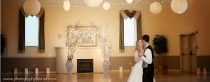 Grand  Ballroom, Grand Ballroom and Theatre, Salem — Elegantly decorated wood dance floor with twinkle lights and ceiling lanterns.  Disco ball to add sparkle to your dance.  Since we mainly do weddings, little decoration is needed in our facility.