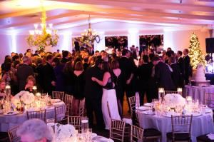 Ballroom, The Inn At Longshore, Westport — Guests dancing and enjoying a New Year's Eve wedding in The Grand Ballroom