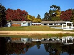 Off-season Weekday Discount --- Doswell Hall --- Save 20%, Cedar Crest Conference Center, Green Bay — View of facility from the other side of the lake.  Large event space on the right, along with gazebo.  Two smaller spaces on the left.  Decks between each room.