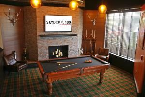 The Den, SKYBOKX 109 GastroSports, Natick — Enjoy our Den area for smaller gatherings complete with plush seating, pool table, and big screen television.