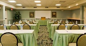 Garden Meeting Room, Hilton Garden Inn St. Augustine Beach, Saint Augustine — Our 1,200 sq. ft. of meeting room rental with a maximum seating capacity of 80 people banquet style, includes our rectangle six foot tables, chairs, and light green linens.