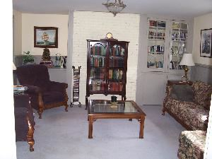 Library, Cambridge House Bed And Breakfast, Cambridge — The library offers a great meeting space in a more casual setting. Kick off your shoes and get comfortable in a large wing chair, on the sofa, or even on the floor! Easily seats six, and can accomodate a few more. Makes a great break out room too. TV and DVD player in the room.