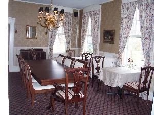 Main Dining Room, Cambridge House Bed And Breakfast, Cambridge — The dining room easily can be converted into a conference room setting that can comfortably seat 10 people. The room also has pocket doors that can be closed to create a separate meeting space from the adjoining parlor.