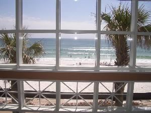 Beach Walk Crystal Beach, Destin — Beach Walk Crystal Beach is like the one and only heir to a rich tycoon. Its back wall (two stories, all glass) opens to a view that isn't of a beach-off-in-the-distance but an immediate, present beach. It's an arm's length from the nearest indoor table and practically merging with the deck outside. Coconut white and wisped with seagrass, it barely holds back the green-blue Gulf of Mexico.