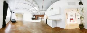 "8443 Warner Studio, Culver City — 8443 Warner is the perfect place for private parties of up to 150 guests.The kitchen counters are butcher block and the bathroom is like a spa.  The 1500 sq. ft. main room can be arranged to accommodate any function.  The roll up door opens to an additional 1000 sq. ft. common area for larger parties.  Play your own iTunes through our wireless AirTunes or directly plug in an iPod.  The Bose speakers drench the space in sound.  Or watch your favorite sports event through the Epson projector on the 12'Hx20""W projection screen."
