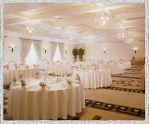 Franciscan Ballroom, Hotel Albuquerque at Old Town, Albuquerque — This 3,850 square-foot ballroom is reminiscent of the prestige and glamour of the Pueblo Deco period popular in the southwest in the 1930s and 1940s. The ballroom features an elaborate Native American inspired geometric layered ceiling and wainscoting painted in various shades of cream, ivory and white. A custom designed Two Gray Hills patterned carpet is designed in shades of gray, brown, cream, and black. Hand-forged thunderbird wall sconces and large-scaled wooden chandeliers with mica glass, as well as large multi-paned windows provide a gorgeous, country club feel for any event.