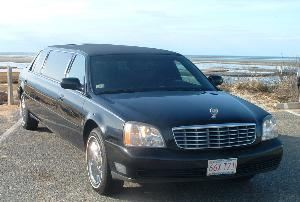 Limousine Services of Cape Cod, Brewster — We are a limousine company that focuses on our clients by providing a V.I.P. service.  Our service is of top quality, while keeping in mind the little details that help to make their ride enjoyable. Bite size snacks. Tic tacs. 8 Ounce serving size of bottle water, soda or juice on ice. Fine white tulle with small silk flowers that gives an added touch for weddings. The white carpet for weddings and the red carpet for the celebrity style. Opening the doors to holding the umbrella when needed. We offer a pearl white Cadillac Sedan, black 6 passenger Cadillac limouisne, and a black Lincoln Navigator SUV.