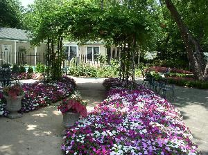 Van Gogh Bar and Lounge, The Sanford House Inn & Spa, Arlington — Lush flowers surround the stone courtyard with it's raised pavilion and octagonal gazebo.  Perfect for outdoor weddings and events