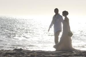 Wedding by Photo, Riverside — Photograph of a wedding on the beach.