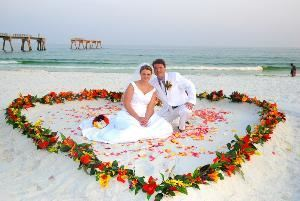 "Navarre Beach Weddings, Navarre — Navarre Beach Weddings and the ""Tropical Heart"" is a beautiful and romantic setup that will include the setup, Minister and the photographer for the wedding ceremony. We travel to Panama City beach, Desti beach, Navarre Beach, Pensacola Beach, Orange Beach, Gulf Shores Beach, and the Emerald Coast of Florida and Alabama for your beach wedding and ceremony."