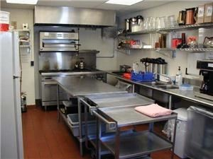 Kitchen, First Unitarian Universalist Society of Albany, Albany — An up to date, fully functional food preparation center is available, consisting of a 6 burner gas stove, industrial dishwasher and stainless tables.