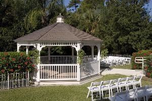 Garden & Gazebo, Best Western Lake Buena Vista Resort Hotel, Orlando — Due to the popularity of weddings the hotel has added a lush garden crisp white gazebo where up to 100 of your guests will have a perfect view of your magical moment taking place.