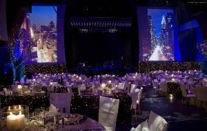 styled INSPIRATIONS - Worldwide Services, Los Angeles — This annual Elegant Holiday Gala was held at a local Performing Arts Center featuring headline entertainment that evening.  The challenge and excitement was to create and transform a 2,000 capacity theatre for a sit down dinner and show into a New York Central Park environment complete with trees, and scenery at eye level encomapassing the entire room.