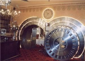 The Vault, The Broker Restaurant, Denver — This front door weighs 23 tons. Inside are four dining rooms. Two of these rooms (the A Room and the B Room) are used for private corporate dinners for up to eight guests.
