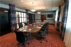 Executive Boardroom A, Hilton Cincinnati Airport, Florence — Each Executive Boardroom has a pull-down screen and can accommodate up to 12 people.
