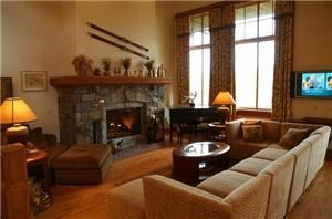 Resort Home at Spruce Peak in Stowe, Stowe — A fabulous living room, dining room, kitchen, open plan with spectacular mountain and lake views from the floor to ceiling windows. Event guests can stay overnight and relatives and friends can have a more meaningful time than in separate hotel rooms. This lovely home is also a wonderful venue for retreats, reunions, parties, meetings, romantic getaways, and family vacations.