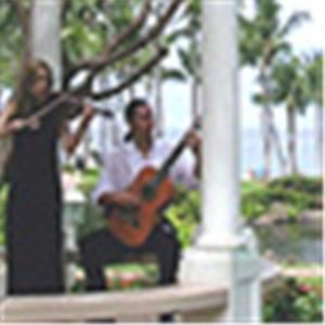 Maui Romantic Classical/Jazz Violin & Guitar Duets, Kihei — Classical/ Jazz Violin & Guitar duet! We have a diverse repertoire of romantic jazz, film & show tunes, classical duets, love songs, wedding music, Celtic tunes, Tangos, Pat Metheny tunes, Andrea Bocelli, Beatles & Coldplay songs. Brazilian Bossa Nova & Choros for an exotic, tropical island feel. Enhance your celebration! Solo or ensemble also available. 808-283-6945 See Makena beach music video on our website: www.MauiWeddingMusic.com