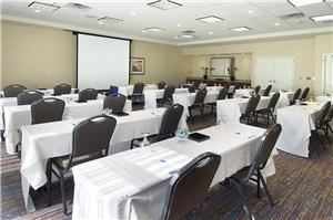 Meeting Room  C, Hilton Garden Inn Rockford, Rockford — Flexible set ups for a maximum of 50. Wireless internet, drop down screen, note pads, pens, mints, and water service included. Onsite Catering available.