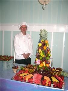 Scrumptious Suppers, LLC, Harrisonburg — Chef Vic standing by the fruit tree display