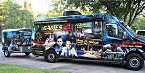 "Games2U, Hilo — The Games2U Mobile Video Game Entertainment Theater brings the party to your location.  Our Mobile Game Theater is a fully self-contained, climate controlled gaming vehicle with surround sound system and light show.  The state-of-the-art vehicle consists of 5 - 42"" HDTV flat screen video monitors, three on the inside providing Xbox 360 gaming and 2 on the outside providing Wii gaming, allowing up to  20 players to play simultaneously. We offer a huge library of the hottest new games to choose from, suitable for all age groups and interests.  Also, Games2U brings outdoor laser tag for 20 players right to your location and can be played during the day or at night."