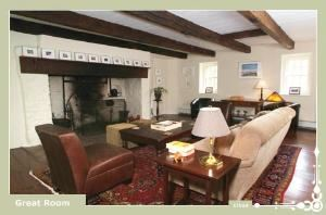 Great Room, Inn At Glencairn, Princeton — Great Room with a twelve foot wide original cooking fireplace, and is decorated with fine antiques throughout, a revolving art collection, and oriental carpets over random width pine floors.