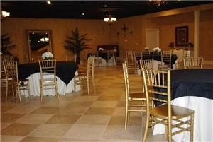 Elegant Memories, Baton Rouge — Our Ballroom is set to your request with floorlength ivory drapes on round tables with black or ivory toppers. Framed by Gold Chivari Chairs and silk centerpieces.