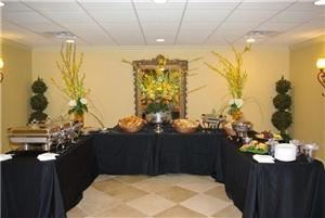 Elegant Memories, Greenwell Springs  Our Buffet is displayed with Black floorlength table drapes and Pewter and Silver serviceware.