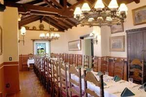 Portola, El Adobe De Capistrano, San Juan Capistrano — this long private room with thick adobe walls, stained glass window niches, and artfully restored vaulted wood ceiling is perfect for small group dining.Portola seats up to 40 guests